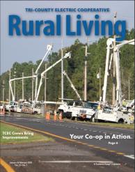 Cover of January-Feb Newsletter several bucket trucks working on transmission line