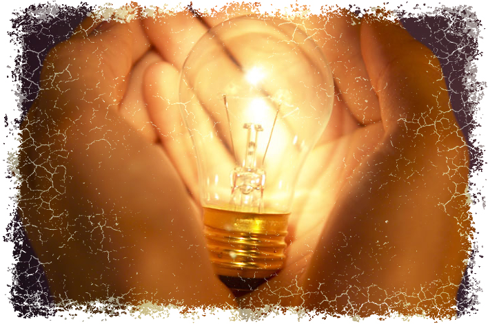 A Pair of Hands Holding a Lightbulb